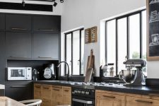 14 a modern industrial kitchen with metal and wooden cabinets, metal countertops, spotlights and a dining zone right here