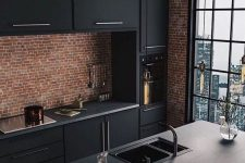 16 a fantastic industrial kitchen with red brick walls, black metal cabinets, concrete countertops and bulbs hanging over the space