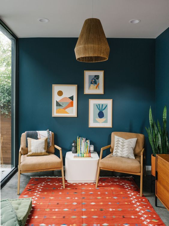 cool mid-century modern chairs and a coffee table, a bright gallery wall and printed textiles are lovely for a millennial living room