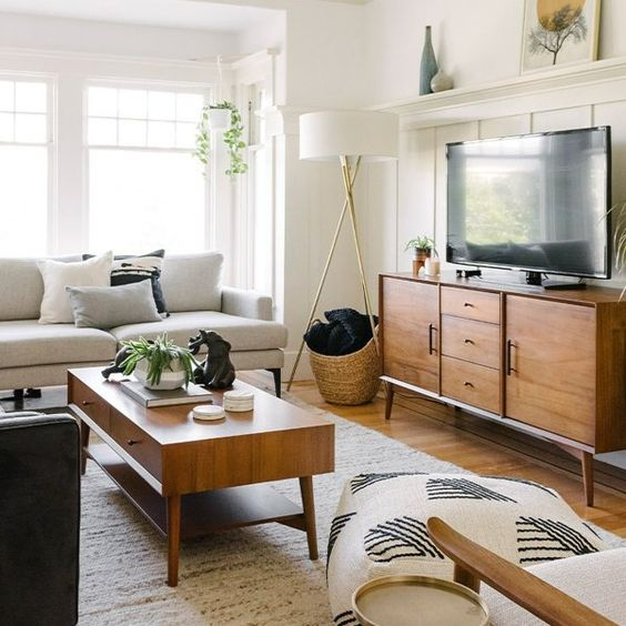 stained mid-century modern furniture - a TV unit and a coffee table add chic and coziness to the living room