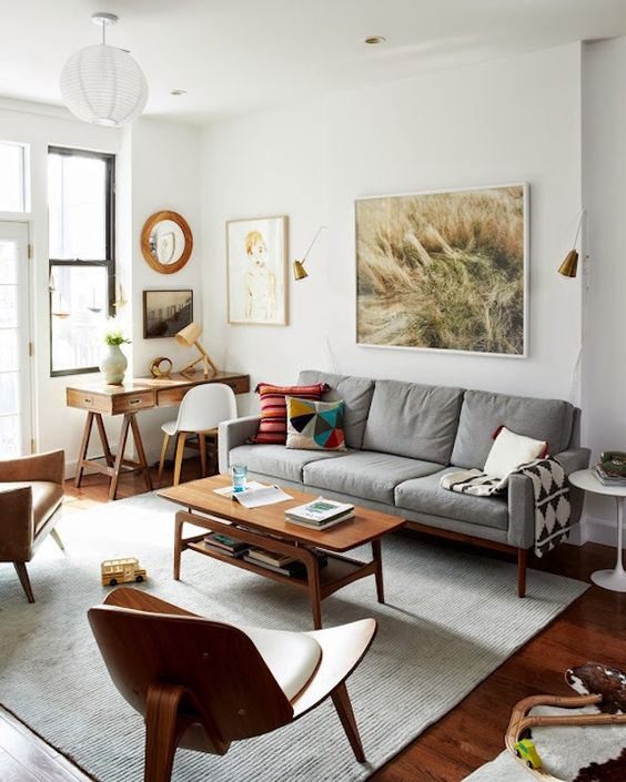 an elegant and chic mid-century modern living room with stylish furniture - a plywood chair, a wooden coffee table and a desk