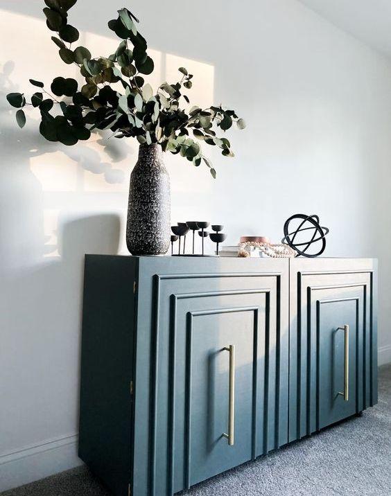 a plain Kallax shelf turned into a glam art deco furniture piece in navy blue is a very stylish idea