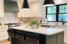 23 a chic modern kitchen with white and grey cabinets, a white chevron tile backsplash, black stools and black pendant lamps