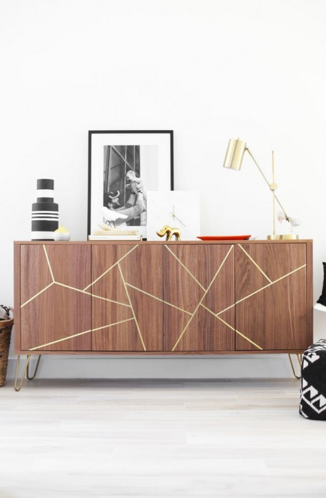 a Stockholm sideboard with gold hairpin legs and a geometric design made with gold foil tape
