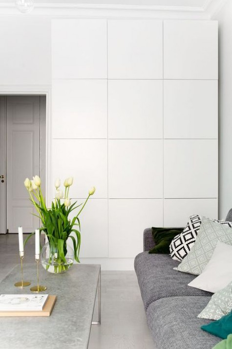 such a large wall storage unit made of IKEA Besta doesn't look heavy and is rather sleek, ideal not only for a living room
