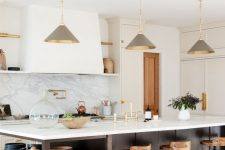 26 a chic farmhouse kitchen with white shaker style cabinets, a dark stained kitchen island with open shelves, grey pendant lamps