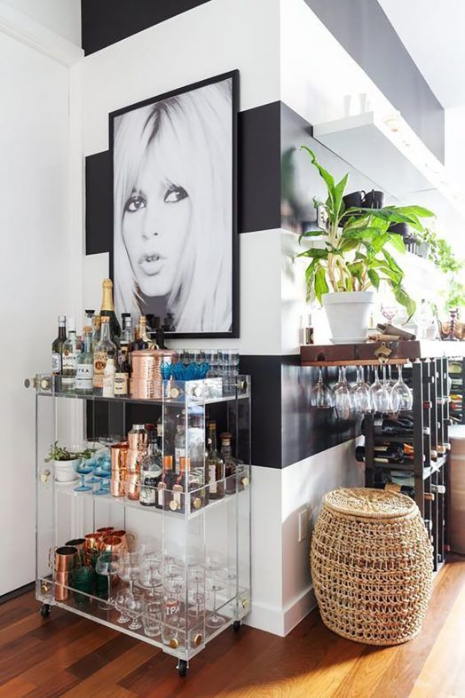 a beautiful sheer glass bar cart is a cool idea that can easily match a mid-century modern space