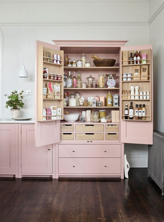 a pink mini pantry built into the kitchen is a lovely idea to store a lot of things and organize them at your best