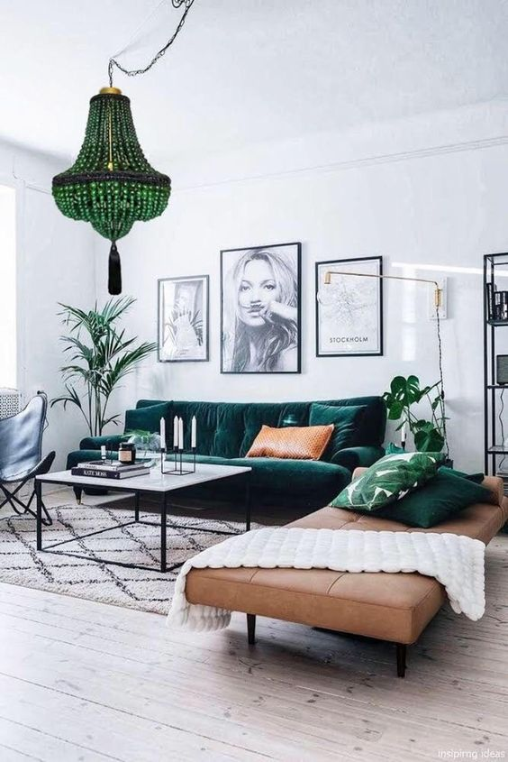 a chic black and white gallery wall in matching frames is a cool accent to the living room and is easy to recreate