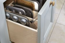 32 a drawer for storing baking trays and other stuff necessary for cooking is a smart idea for a millennial kitchen