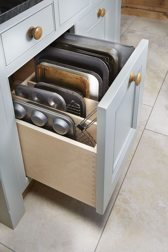 a drawer for storing baking trays and other stuff necessary for cooking is a smart idea for a millennial kitchen