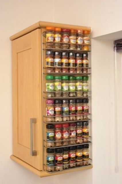 a cabinet with a mini spice rack attached to the side will hold a lot of spices easily