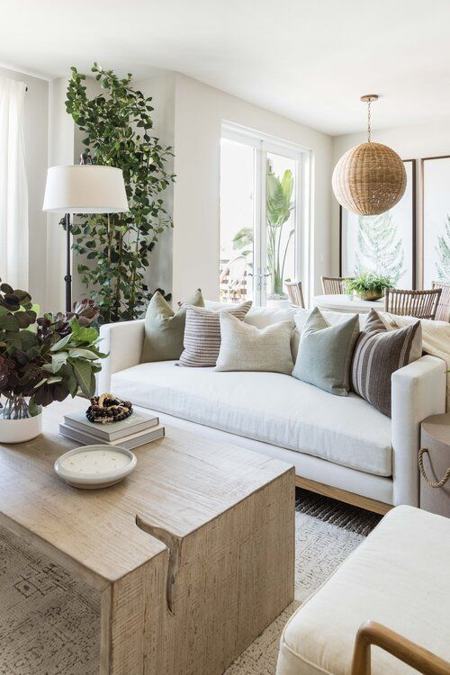 a neutral and chic living room and dining space dotted with amazing potted greenery and trees items is a very fresh idea