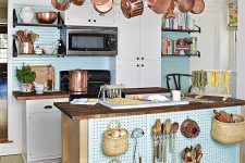 37 a kitchen island on wheels and with pegboard with hooks for storing stuff plus a ladder for hanging things over it