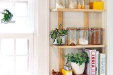 38 a small open shelf taking an awkward nook will let you store a lot of stuff without grabbing precious cabinet space
