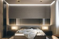 a beautiful contemporary bedroom done in elegant neutral tones, with several layers of light, a bed and matching sleek nightstands plus a long mirror