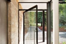 a black framed pivot front door gives a very stylish and ultra-modern feel to the space and makes it wow, bold and cool