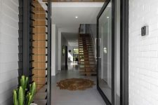 a black metal frame and glass pivot door looks very stylish and allows much natural light in and you will always see who's coming