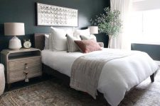 a boho master bedroom with dark green walls, a cool bed and eye-catchy nightstands, a potted plant and printed textiles