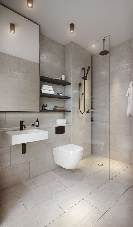 a clean contemporary bathroom clad with neutral tiles, a shower space, a mirror, black shelves and black fixtures