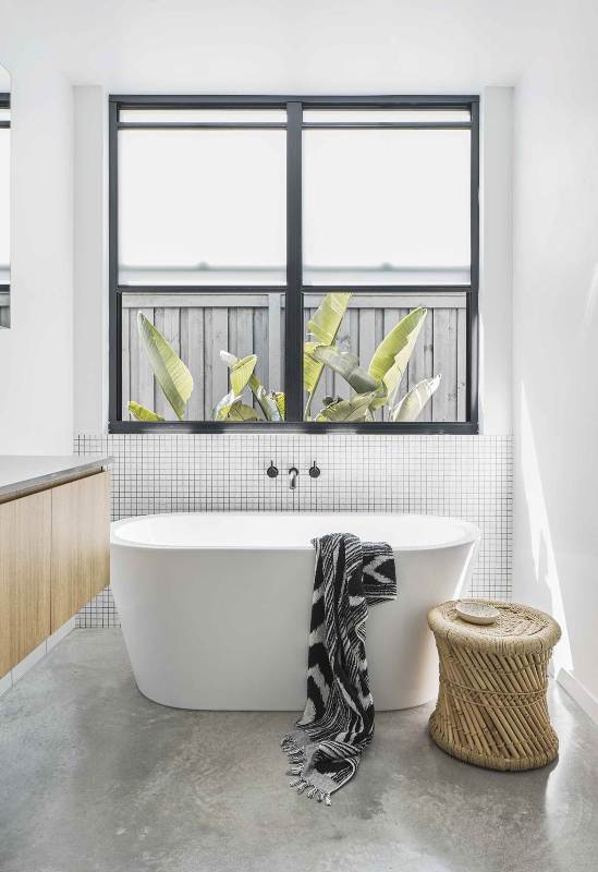 a contemporary bathroom design with concrete floor