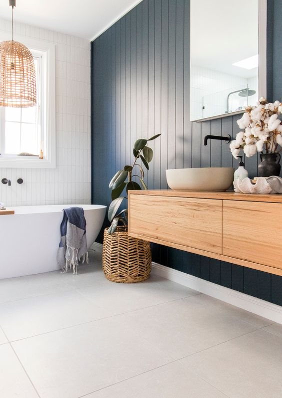 a stylish bathroom with a navy accent wall
