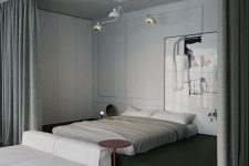 a contemporary bedroom with a bed on a green platform, a statement artwork, a soft white sofa and curtains to hide the bed and get more privacy