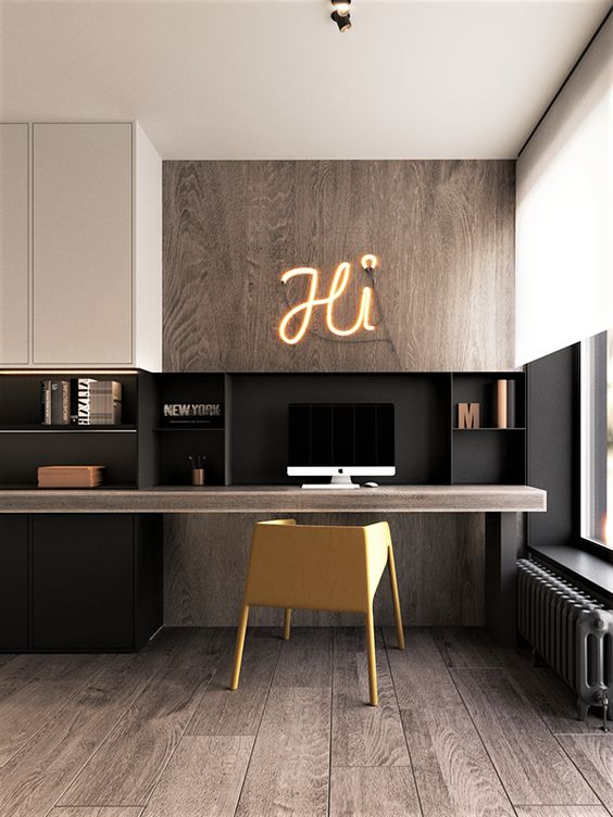 a contemporary home office with light stainted wood, black and white touches, a floating desk and sleek storage units and a yellow chair
