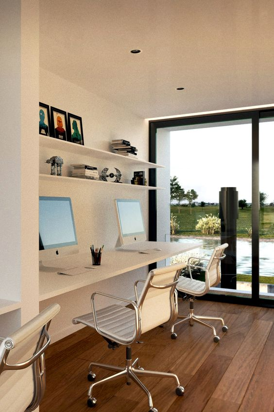 a contemporary shared home office nook by a glazed wall, with a floating desk, white chairs, open shelves and a lovely view