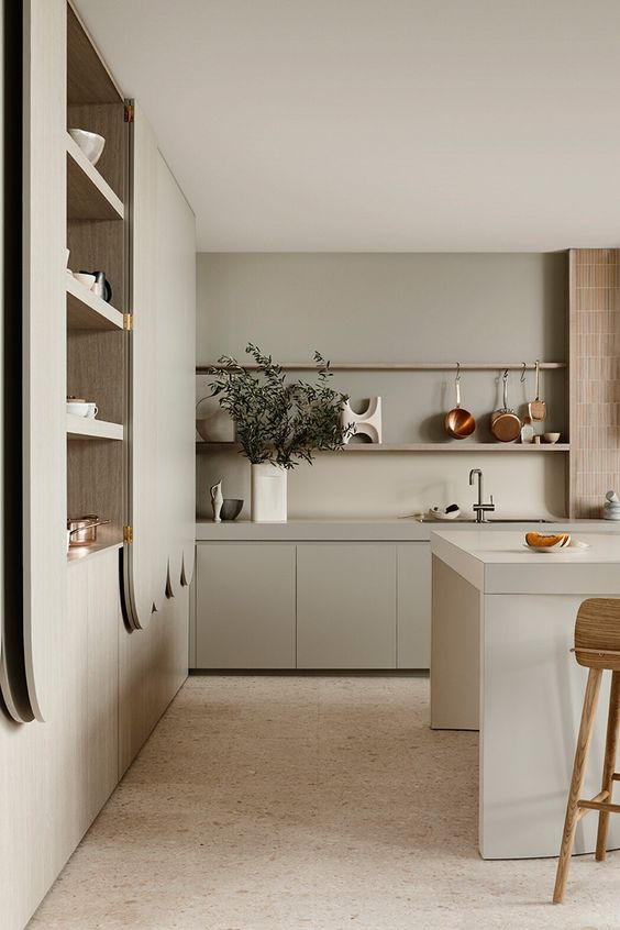 a dove grey contemporary kitchen with sleek cabinets, a bamboo backsplash, catchy curved details and open shelves is amazing