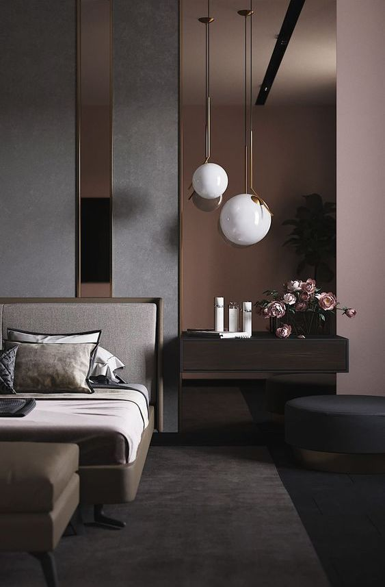 a dreamy contemporary bedroom with an accent wall done with dark mirrors, a chic bed, a leather ottoman, a floating nightstand and a round ottoman