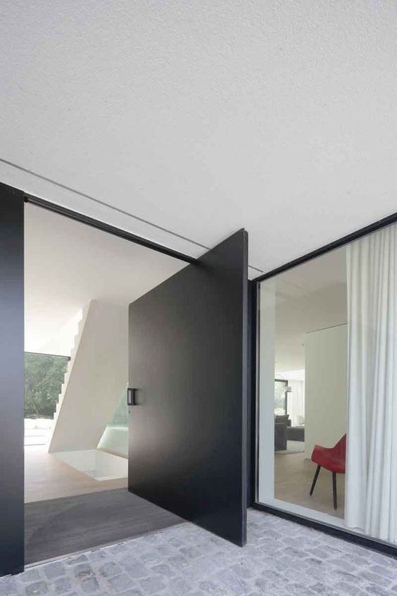 a fantastic sleek black entrance door will make a statement in your home, whether it's an entrance or a back garden door