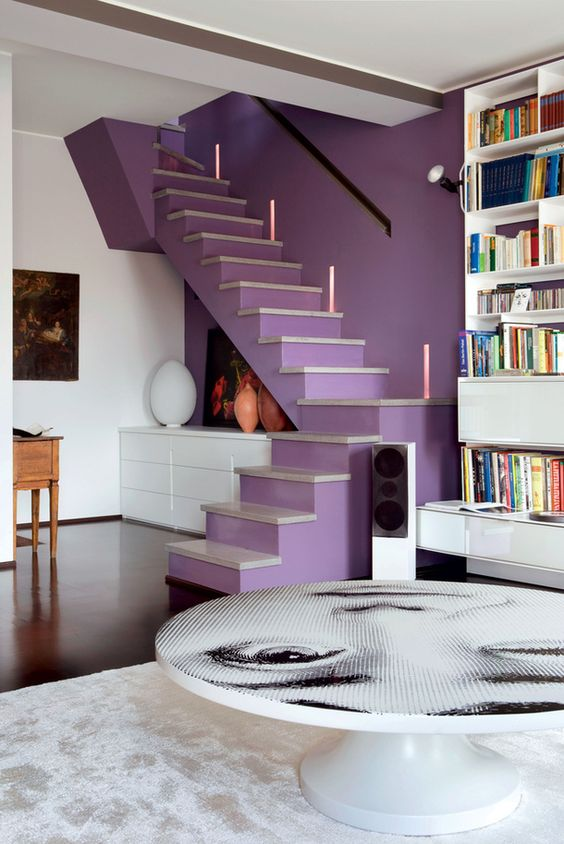 a lilac accent wall paired with a matching staircase gives a lovely touch of color and a unique decor feature to the space