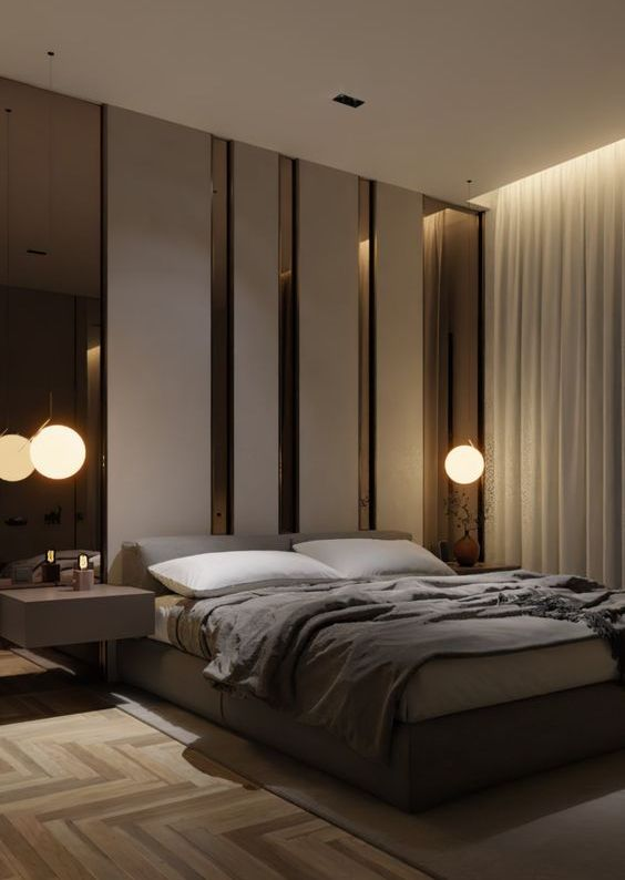 a luxurious contemporary bedroom in neutrals, with an accent headboard wall with mirrors, an upholstered bed, floating nightstands and a parquet floor