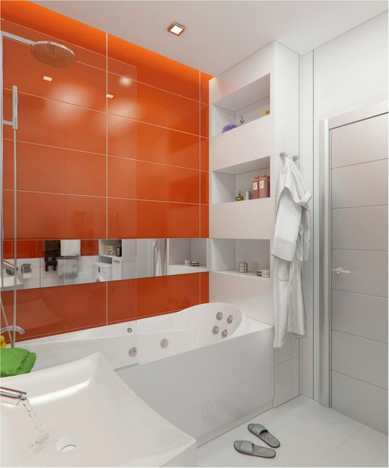 a minimalist bathroom with large scale tiles, an orange accent wall and all white everything is a very bold idea for a contemporary home