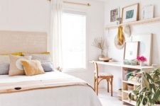 a modern boho bedroom in warm neutrals, with stained furniture, printed textiles and a home office nook that may double as a vanity space