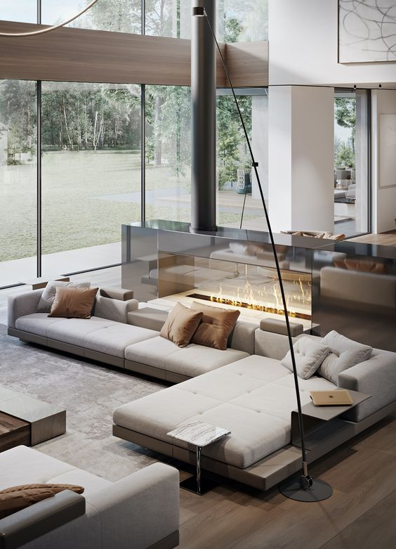 a neutral luxurious living room with a large sectional, a glass fireplace, a table, a daybed is a fantastic lounge zone