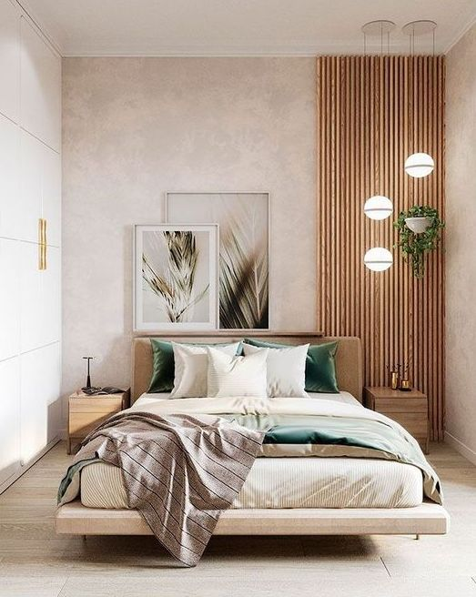 a pretty contemporary bedroom in neutrals, with a wooden slab accent, a floating bed with neutral bedding, a sleek storage unit that takes a whole wall and a cluster of pendant lamps