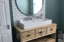 a reclaimed wood bathroom vanity with drawers is a cool idea for a millennial bathroom and it will add a warming touch to the space