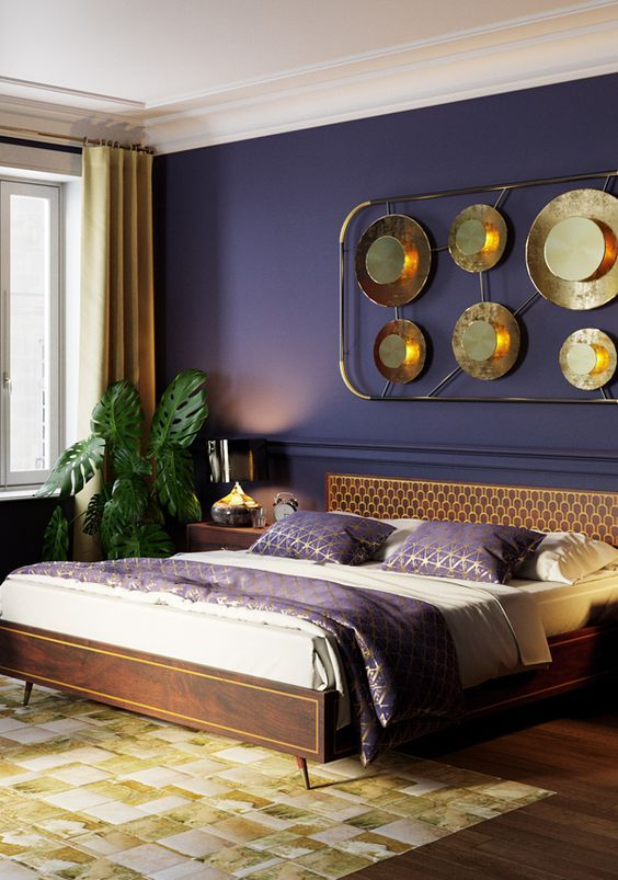 a refined tropical bedroom with a deep purple wall, dark stained furniture, an arrangement with metallic plates, a potted plant