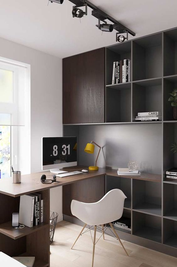 a simple contemporary home office with dark stained storage cabinets and a built-in desk plus open storage units, a white chair