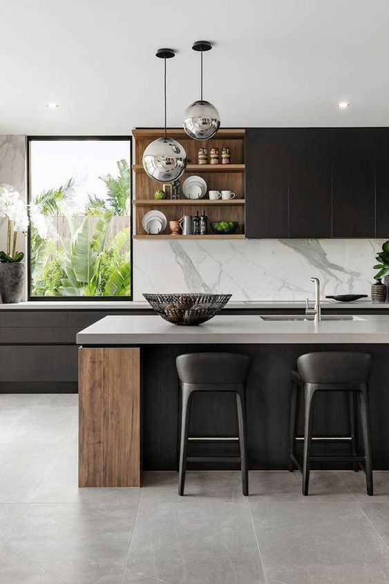 a super refined contemporary kitchen with sleek black cabinets, stained wood elements, white stone coutnertops and a backsplash