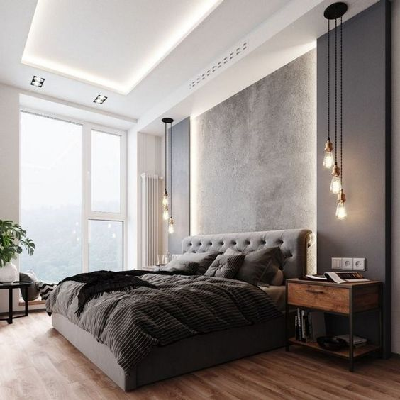 a terrific contemporary bedroom with a lit up ceiling, a grey upholstered bed, black panels on the wall, pendant lamps and a cool view