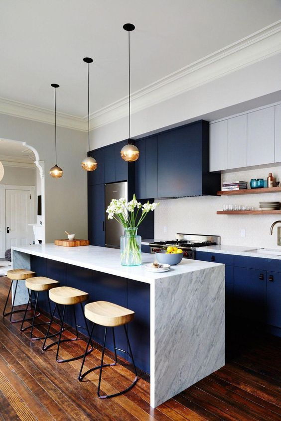 a two tone contemporary kitchen with navy and white cabinets, white stone countertops and a tile backsplash plus open shelves