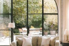 an arched french doors is a great solution to view outdoor space