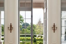beautiful and delicate grey French doors to the garden and matching windows look amazingly chic and bring much natural light inside