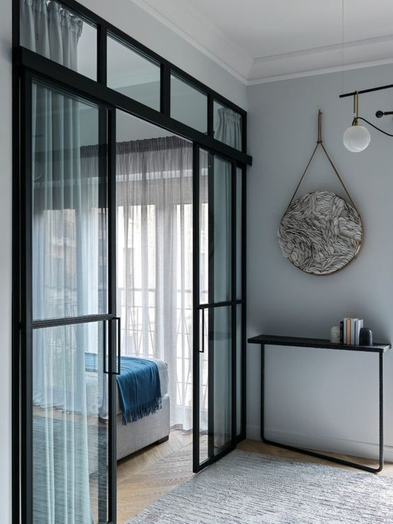 beautiful modern black French sliding doors will let a lot of light in and out and will subtly separate the spaces