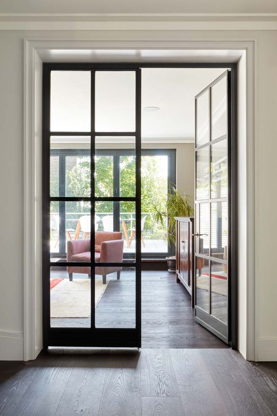 black French doors for inner spaces are a chic idea for many interiors - though they are black, they provide enough natural light