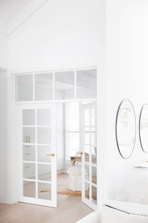 delicate and subtle white French doors will match a neutral space and make the spaces filled with light even more