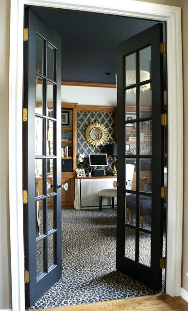 elegant black French doors add chic to the space and make the rooms more lovely and bold and look very lightweight at the same time